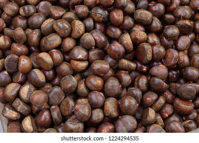 Roasting chestnuts, seen close up