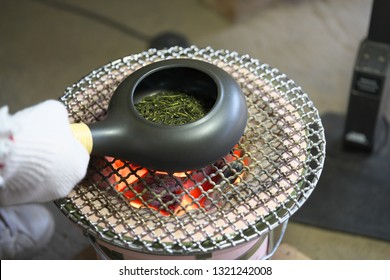 Roasting green tea with an earthenware baking pan on Earthen charcoal brazier. Roasted green tea is called Hojicha in Japanese.