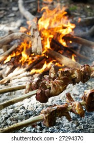 Roasting lamb on open fire