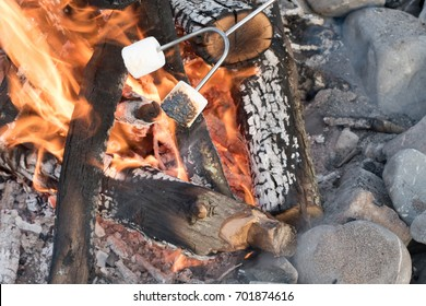 Roasting Marshmellows at a Beach Bonfire with Chocolate, Marshmellow, and Graham Crackers with Room for Copy