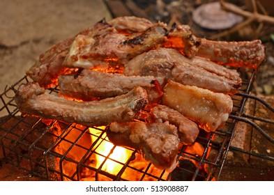 Roasting pork rips on hot fire