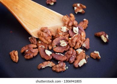 Roasting Walnuts. Close up.