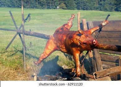 Roasting whole pig