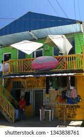 Roatan, Honduras - April 5 2008: The shops and the street in Roatan Island, the largest island in Bay Islands.