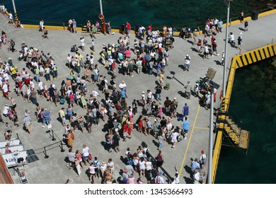 Roatan, Honduras - April 5 2008: The tourist are getting off from the cruise ship in the pier in Roatan Island, the largest island in Bay Islands.