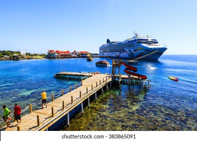 ROATAN ILAND HONDURAS JAN 28 2016:Ctruise ships docked near the bay at Coxen Hole, Roatan Town,  with a population of 5,070, Favorite spot for cruise ships and tropical lover vacationers
