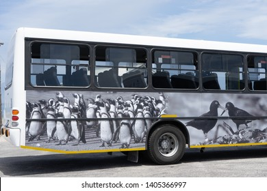 Robben Island, Cape Town, South Africa, November 13/2018 - The tourist bus decorated with animal motifs for the round trips on Robben Island.  Penguins and African black oystercatchers are on the bus.