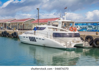 ROBBEN ISLAND, SOUTH AFRICA - DECEMBER 19, 2016: Photo of luxury 55 foot power cat docked at  Robben Island where Nelson Mandela, later President of South Africa was in prison for 18 years