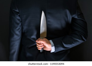 Robber with big knife - a killer person with sharp knife about to commit a homicide, murder scenery