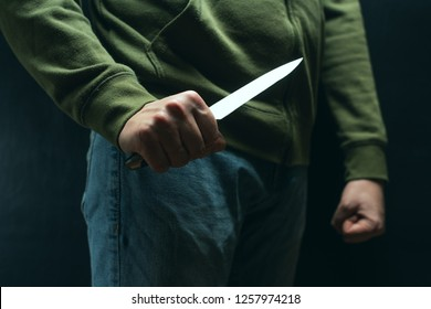 A robber with a big knife - a sharp-assassin murderer about to commit murder, robbery, theft. News articles, newspaper, social advertising