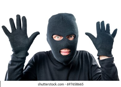 Robber in black protective clothing with hands up close-up portrait