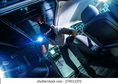 Robber with Flashlight Inside Cargo Van at Night.