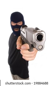 A robber with hidden face points his gun in a robbery attempt.