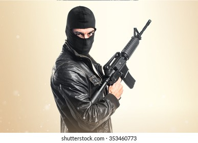Robber holding a rifle