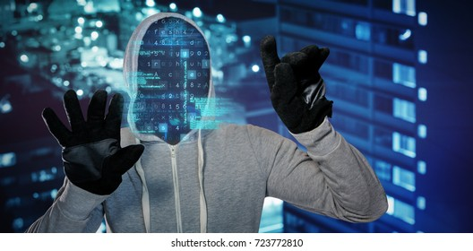 Robber with hood and gloves against high angle view of crowded buildings in city