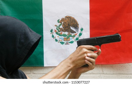 Robberies with gun in hand. Robbery. Hand with gun with Mexico flag background
