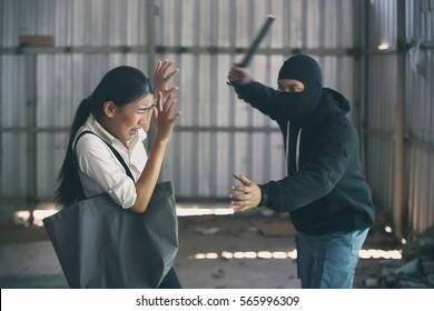 Robbers attack woman. Dangerous criminal man. Theft robbing young female.