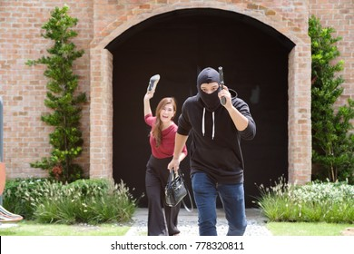 Robber/Thief running away quickly from victim after steal her bag,Asian woman throwing her shoe to their and yelling for help, criminal robbery concept