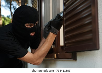 Robbery or burglary. break-in of an apartment. Thief in mask