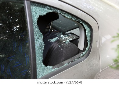 Robbery - closeup photo about a car's broken window