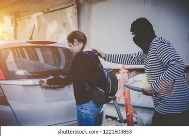 Robbery with a firearm secretly hide behind walls.The Girl shocked after being pulled bag.Concept of unsafe woman in the city.