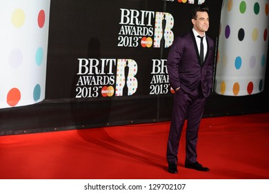 Robbie Williams arrives for the Brit Awards 2013 at the O2 Arena, Greenwich, London. 20/02/2013 Picture by: Steve Vas
