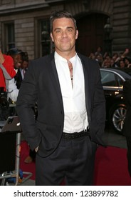 Robbie Williams arriving for the 2012 GQ Men Of The Year Awards, Royal Opera House, London. 05/09/2012 Picture by: Henry Harris