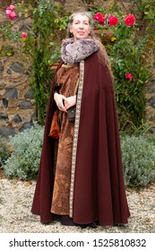 Robed long hair lady in medieval clothing