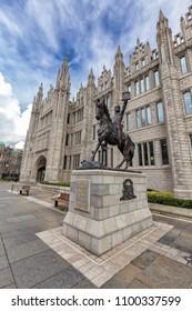 Robert the Bruce Statue in front of Marischal College in Aberdeen, United Kingdom.