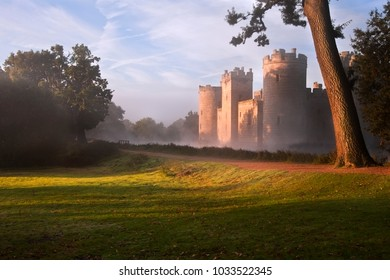 ROBERTSBRIDGE, UK - OCTOBER 14, 2012 - Medieval moat and Bodiam Castle landscape image during misty foggy Autumn morning