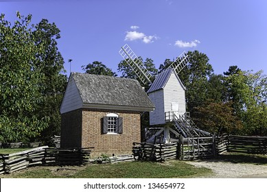 Robertson's Windmill and rustic fencing in Colonial Williamsburg, Virginia. The windmill was constructed for the purpose of grinding small grains.
