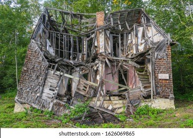 Roberval, Canada - september 2019: ruin of a wooden house in the ghost historical village of Val-Jalbert