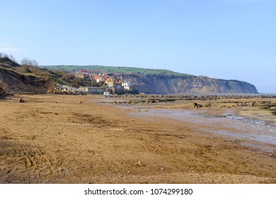 ROBIN HOOD'S BAY, APRIL 21: Robin Hood's Bay beach on a hot, sunny day in April. In Robin Hood's Bay, England. On 21st April 2018.