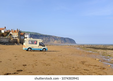 ROBIN HOOD'S BAY, APRIL 21: Traditional ice cream van on Robin Hood's Bay beach. In Robin Hood's Bay, England. On 21st April 2018.