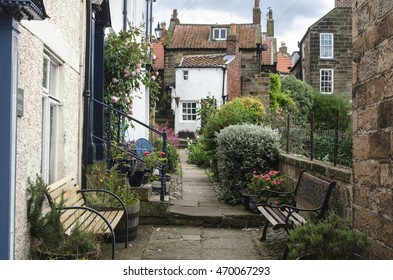 ROBIN HOOD'S BAY, ENGLAND - AUGUST 2016: A view on the lovely houses in a town on the Yorkshire coast in Robin Hood's Bay in England on 15 of August, 2016