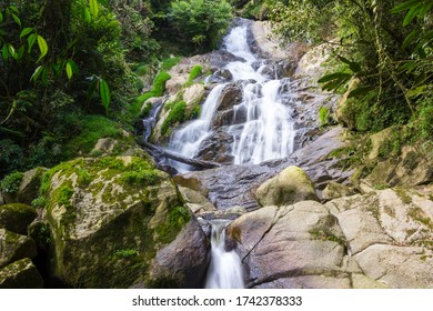 Robinson Falls Cascading over Boulders in the Cameron Highlands
