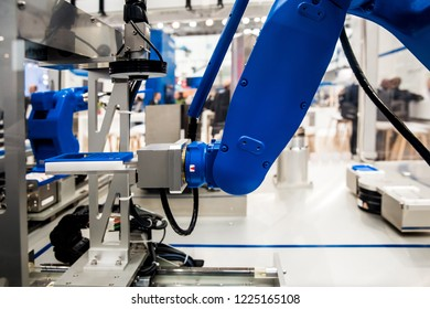 Robot arm in assembly line