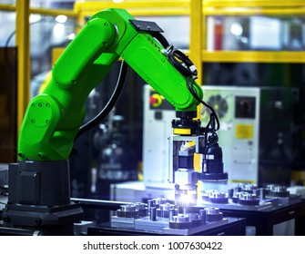 Robot arm in machine tool metalworking process for industry manufacture,CNC metal machining.