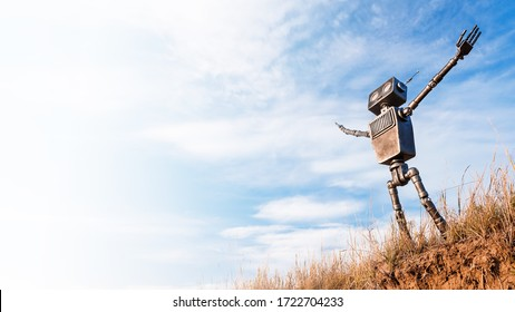 Robot with arms raised looks up at the sky