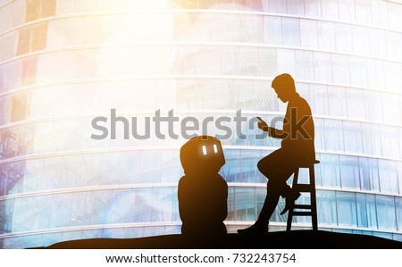 Robot assistant technology , industry 4.0 , artificial intelligence trend concept. Silhouette of business man talking to automation robo advisor. Bokeh flare light effect with building background.