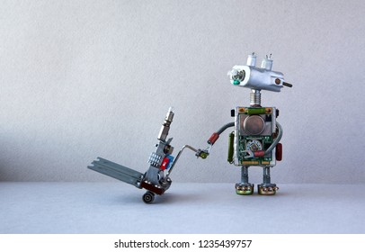 Robot courier with pushcart. Gray wall floor background. Copy space.