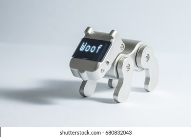A robot dog with the word 'woof' across its communication panel.