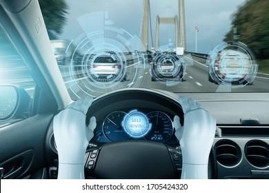 The robot drives a car. Autonomous driving