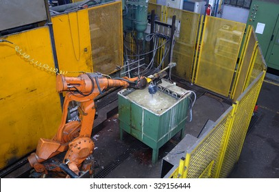 robot in an engine factory,