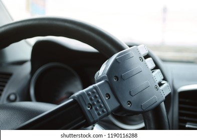 Robot hand on the car steering wheel. Robot pilot is driving a car concept.