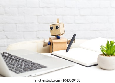 A robot with hands is sitting at the desk. Artificial Intelligence
