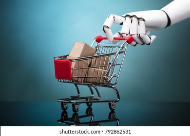 Robot Holding Shopping Cart With Cardboard Boxes On Turquoise Background