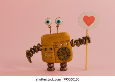 robot holds a sign heart