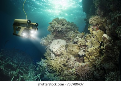 Robot inspects a sunken ship deep under water