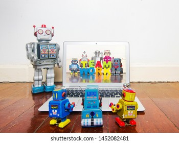 robot kids learn about team work  on a laptop